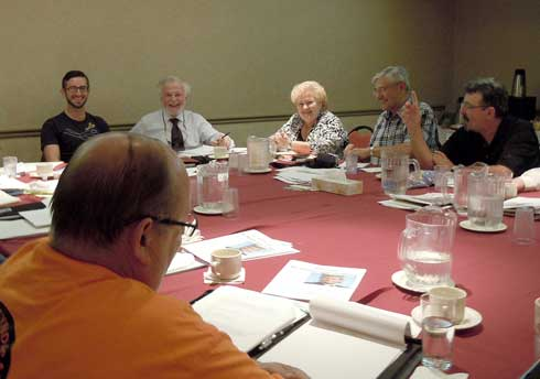 Canadian Federation of Students President Adam Awad discusses issues with the CURC Executive at their meeting in June.