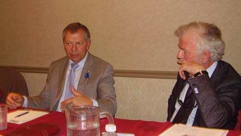 Federal Minister of State for Finance Ted Menzies (l) and CURC President Pat Kerwin discuss issues at their meeting in June.