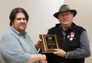 Henry receiving the award from HDLC President Anthony Marco.