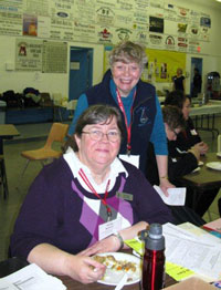 Holly Schick, a conference facilitator (seated) and SFUR President Betty Pickering.