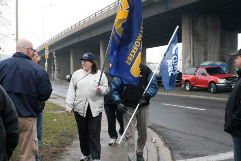 CURC Hamilton-Burlington-Oakville Area Council Treasurer Lena Sutton shows the flag at a solidarity picket for US Steel workers.