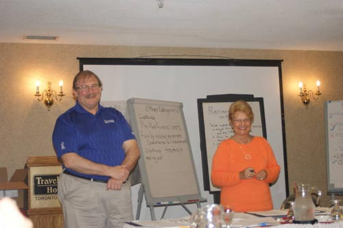 Ted Hext of Sarnia and Sandi Ellis of Waterloo instruct a session on finances